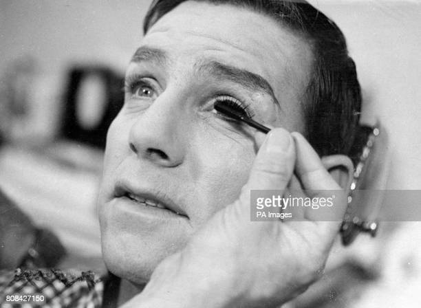 Norman Wisdom as a glamorous blonde nurse should be an eyeopener for the cinema goers The cunning hand of makeup artists George Blackler is seen here...