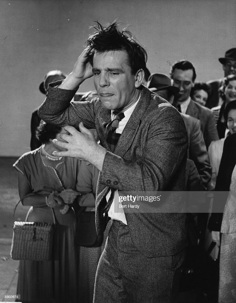 Norman Wisdom, the British slapstick comedian who also works on stage and television, in a scene from his film debut 'Trouble In Store', directed by John Paddy Carstairs for GFD/Two Cities. Original Publication: Picture Post - 6887 - Will Norman Wisdom Be Another Charlie Chaplin - pub 1954