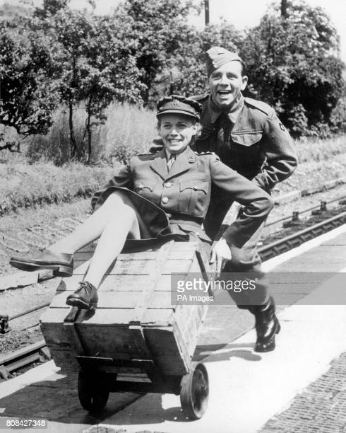 Norman Wisdom who served in the British Army as a private for 10 years before he started his climb to stardom as a comedian is wearing battledress...