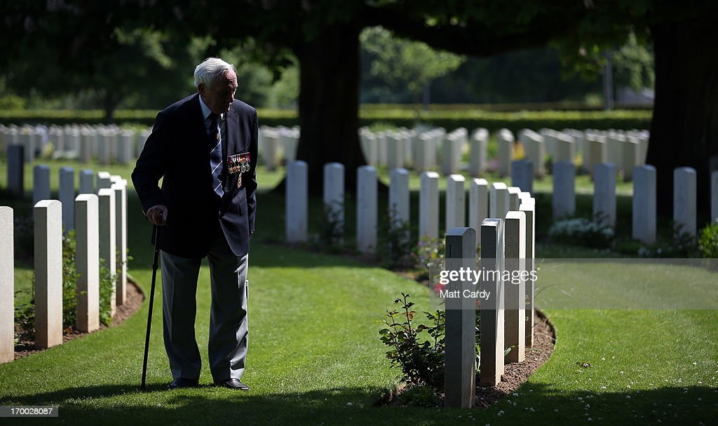 Normandy Veteran 90-year-old Eric Gibbons looks at the headstones of fallen comrades at a remembrance and wreath laying ceremony to commemorate the start of the D-Day landings at Bayeux War Cemetery on June 6, 2013 in Bayeux, France. Across Normandy several hundred of the surviving veterans of the Normandy campaign are gathering to commemorate the 69th anniversary of the D-Day landings which eventually led to the Allied liberation of France in 1944. Next year, which will mark the 70th anniversary of the landings, is widely expected to be the last time that the veterans will gather in any great number.