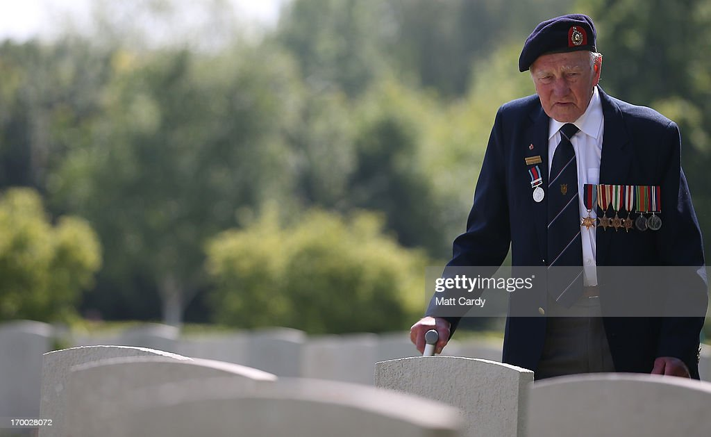 A Normandy Veteran looks at the headstones of fallen comrades at a remembrance and wreath laying ceremony to commemorate the start of the D-Day landings at Bayeux War Cemetery on June 6, 2013 in Bayeux, France. Across Normandy several hundred of the surviving veterans of the Normandy campaign are gathering to commemorate the 69th anniversary of the D-Day landings which eventually led to the Allied liberation of France in 1944. Next year, which will mark the 70th anniversary of the landings, is widely expected to be the last time that the veterans will gather in any great number.