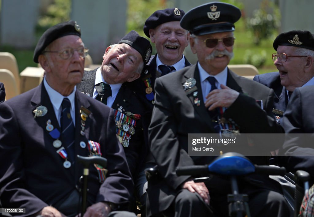 Normandy Veterans, joke around as they attend a remembrance and wreath laying ceremony to commemorate the start of the D-Day landings at Bayeux War Cemetery on June 6, 2013 in Bayeux, France. Across Normandy several hundred of the surviving veterans of the Normandy campaign are gathering to commemorate the 69th anniversary of the D-Day landings which eventually led to the Allied liberation of France in 1944. Next year, which will mark the 70th anniversary of the landings, is widely expected to be the last time that the veterans will gather in any great number.