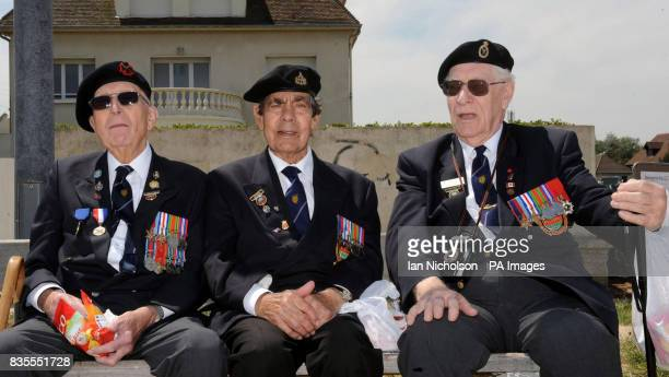Normandy veterans Percy Lewis of 1st Bucks Battalion Vic Blake of 43 Wessex B Squadron and George Lines of Royal Signals all from Surrey enjoy a...