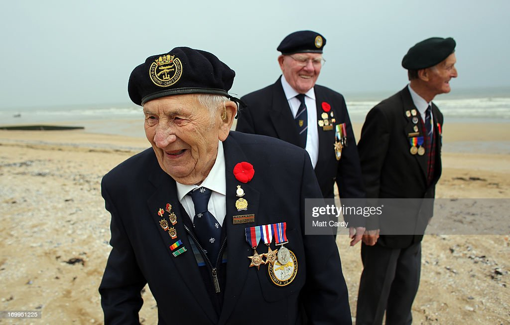 Normandy veterans (L-R) Victor Urch, 88 and Frank Baugh, 89 (who were in the Royal Navy dropping troops and supplies onto Sword Beach) and Derek Whitehead, 88 (who was in the Durham Light Infantry and was on Gold Beach on D-Day) share a joke as they walk along what was the British Sword beach at Colleville Montgomery on June 5, 2013 near Caen, France. Across Normandy several hundred of the surviving veterans of the Normandy campaign are gathering to commemorate the 69th anniversary of the D-Day landings which eventually led to the Allied liberation of France in 1944. Next year, which will mark the 70th anniversary of the landings, is widely expected to be the last time that the veterans will gather in any great number.