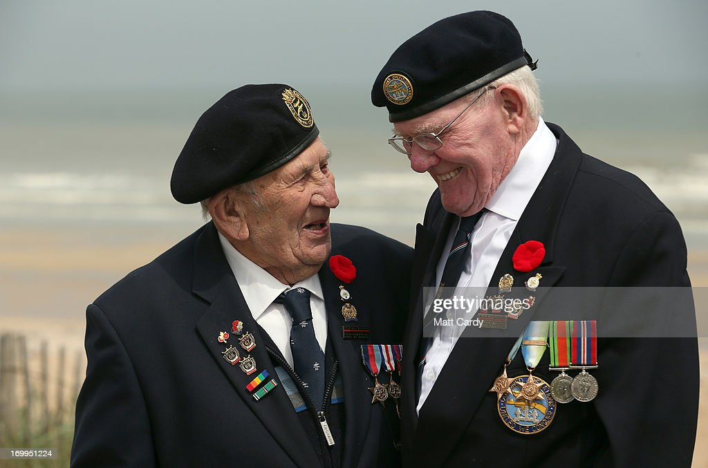 Normandy veterans (L-R) Victor Urch, 88 and Frank Baugh, 89 (who were in the Royal Navy dropping troops and supplies onto Sword Beach) share a joke as they walk along what was the British Sword beach at Colleville Montgomery on June 5, 2013 near Caen, France. Across Normandy several hundred of the surviving veterans of the Normandy campaign are gathering to commemorate the 69th anniversary of the D-Day landings which eventually led to the Allied liberation of France in 1944. Next year, which will mark the 70th anniversary of the landings, is widely expected to be the last time that the veterans will gather in any great number.