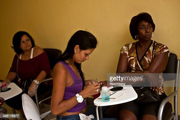 Normangleice Silva Thomaz right has her nails done by Maria Paula at Monica Werneck's beauty salon in the Complexo do Alemao shantytown in Rio de...