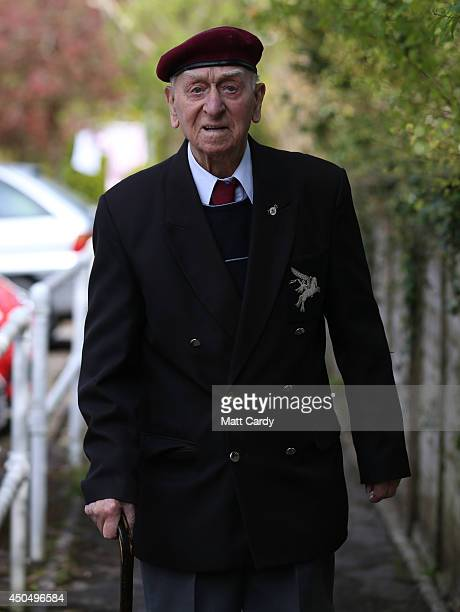 Normany veteran 100yearold Tom Tidmarsh takes a walk in the grounds of his sheltered accommodation in Shepton Mallett on April 17 2014 in Somerset...