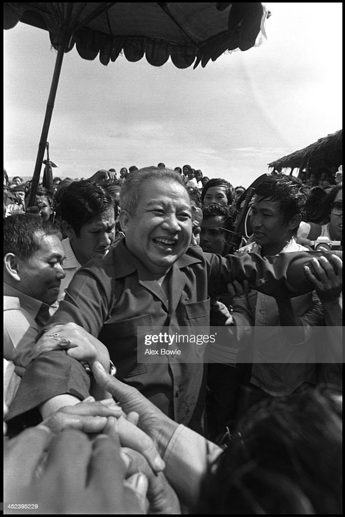 Norodom Sihanouk (31 October 1922 – 15 October 2012) greets supporters at the Khao-I-Dang refugee camp on the Thai-Cambodian border after returning from exile in China, 12th July 1982. Sihanouk was King of Cambodia from 1941 to 1955 and again from 1993 to 2004. He was the effective ruler of Cambodia from 1953 to 1970.