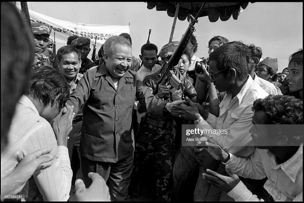 <a gi-track='captionPersonalityLinkClicked' href=/galleries/search?phrase=Norodom+Sihanouk&family=editorial&specificpeople=210861 ng-click='$event.stopPropagation()'>Norodom Sihanouk</a> (31 October 1922 – 15 October 2012) greets supporters at the Khao-I-Dang refugee camp on the Thai-Cambodian border after returning from exile in China, 12th July 1982. Sihanouk was King of Cambodia from 1941 to 1955 and again from 1993 to 2004. He was the effective ruler of Cambodia from 1953 to 1970.
