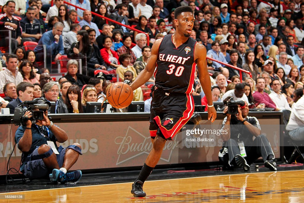<a gi-track='captionPersonalityLinkClicked' href=/galleries/search?phrase=Norris+Cole&family=editorial&specificpeople=5770147 ng-click='$event.stopPropagation()'>Norris Cole</a> #30 of the Miami Heat advances the ball against the Philadelphia 76ers on March 8, 2013 at American Airlines Arena in Miami, Florida.