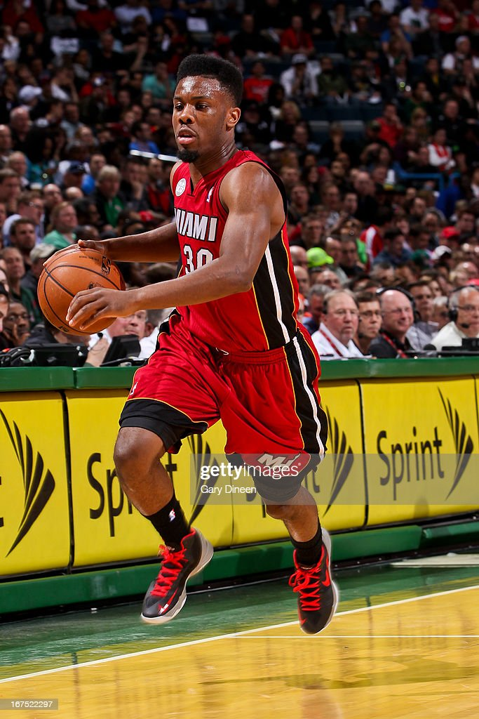 Norris Cole #30 of the Miami Heat advances the ball against the Milwaukee Bucks in Game Three of the Eastern Conference Quarterfinals during the 2013 NBA Playoffs on April 25, 2013 at the BMO Harris Bradley Center in Milwaukee, Wisconsin.