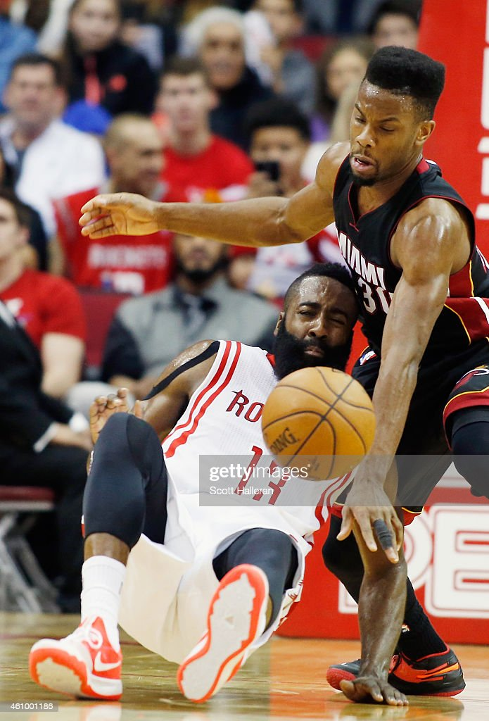 <a gi-track='captionPersonalityLinkClicked' href=/galleries/search?phrase=Norris+Cole&family=editorial&specificpeople=5770147 ng-click='$event.stopPropagation()'>Norris Cole</a> #30 of the Miami Heat battles for the basketball with <a gi-track='captionPersonalityLinkClicked' href=/galleries/search?phrase=James+Harden&family=editorial&specificpeople=4215938 ng-click='$event.stopPropagation()'>James Harden</a> #13 of the Houston Rockets during their game at the Toyota Center on January 3, 2015 in Houston, Texas.