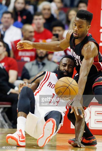 Norris Cole of the Miami Heat battles for the basketball with James Harden of the Houston Rockets during their game at the Toyota Center on January 3...