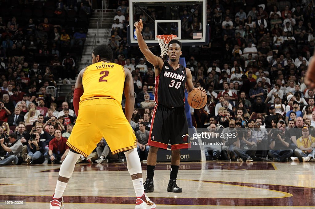 Norris Cole #30 of the Miami Heat calls a play against the Cleveland Cavaliers at The Quicken Loans Arena on April 15, 2013 in Cleveland, Ohio.