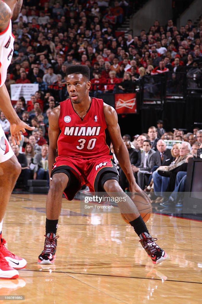 Norris Cole #30 of the Miami Heat dribbles behind his back against the Portland Trail Blazers on January 10, 2013 at the Rose Garden Arena in Portland, Oregon.