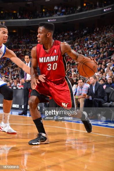 Norris Cole of the Miami Heat dribbles the ball against the Philadelphia 76ers at the Wells Fargo Center on October 30 2013 in Philadelphia...