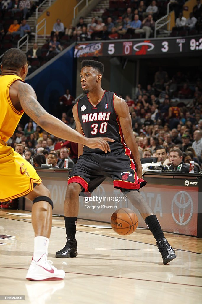<a gi-track='captionPersonalityLinkClicked' href=/galleries/search?phrase=Norris+Cole&family=editorial&specificpeople=5770147 ng-click='$event.stopPropagation()'>Norris Cole</a> #30 of the Miami Heat dribbles the ball against the Cleveland Cavaliers at The Quicken Loans Arena on April 15, 2013 in Cleveland, Ohio.