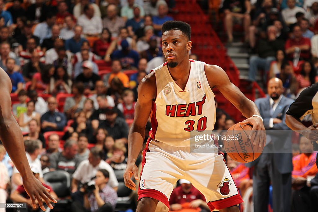 Norris Cole #30 of the Miami Heat dribbles the ball against the New York Knicks during a game on April 2, 2013 at American Airlines Arena in Miami, Florida.