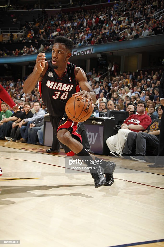<a gi-track='captionPersonalityLinkClicked' href=/galleries/search?phrase=Norris+Cole&family=editorial&specificpeople=5770147 ng-click='$event.stopPropagation()'>Norris Cole</a> #30 of the Miami Heat dribbles the ball up the floor against the Cleveland Cavaliers at The Quicken Loans Arena on April 15, 2013 in Cleveland, Ohio.