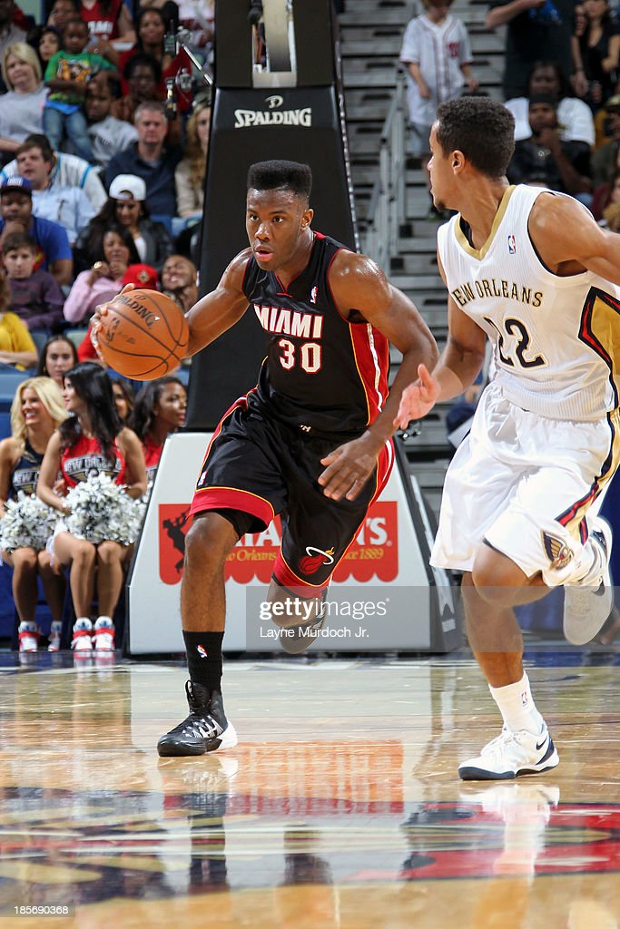 <a gi-track='captionPersonalityLinkClicked' href=/galleries/search?phrase=Norris+Cole&family=editorial&specificpeople=5770147 ng-click='$event.stopPropagation()'>Norris Cole</a> #30 of the Miami Heat dribbles up the floor against the New Orleans Pelicans during an NBA preseason game on October 23,2013 at the New Orleans Arena in New Orleans, Louisiana.