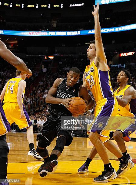 Norris Cole of the Miami Heat drives against Jason Kapono of the Los Angeles Lakers during a game at American Airlines Arena on January 19 2012 in...