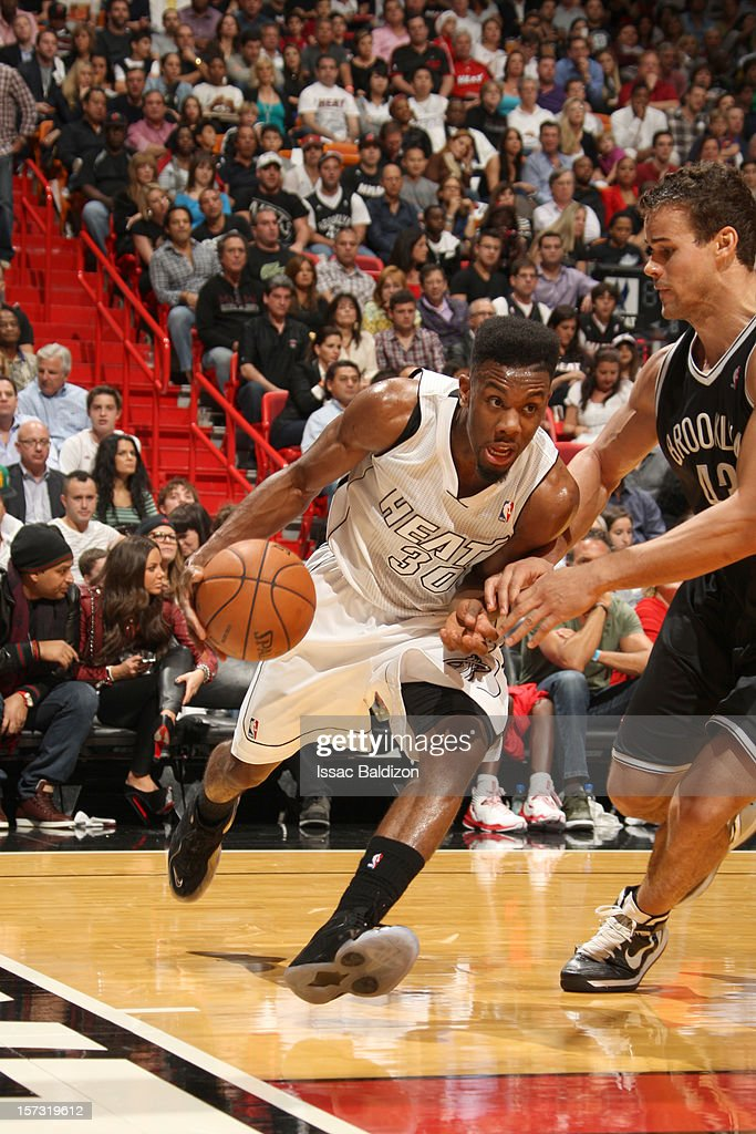 Norris Cole #30 of the Miami Heat drives against Kris Humphries #43 of the Brooklyn Nets during a game between the Brooklyn Nets and the Miami Heat on December 1, 2012 at American Airlines Arena in Miami, Florida.