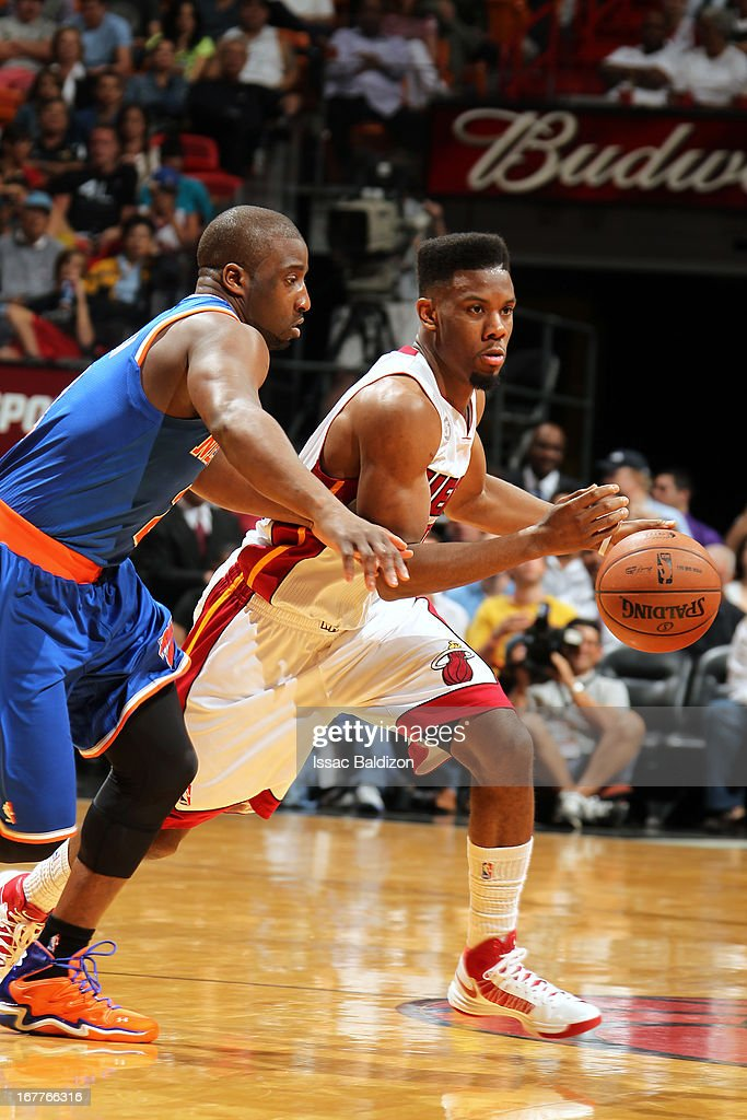 Norris Cole #30 of the Miami Heat drives against Raymond Felton #2 of the New York Knicks on April 2, 2013 at American Airlines Arena in Miami, Florida.