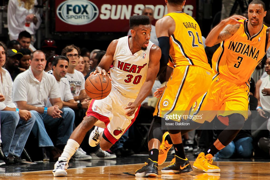 Norris Cole #30 of the Miami Heat drives against the Indiana Pacers in Game One of the Eastern Conference Finals during the 2013 NBA Playoffs on May 22, 2013 at American Airlines Arena in Miami, Florida.