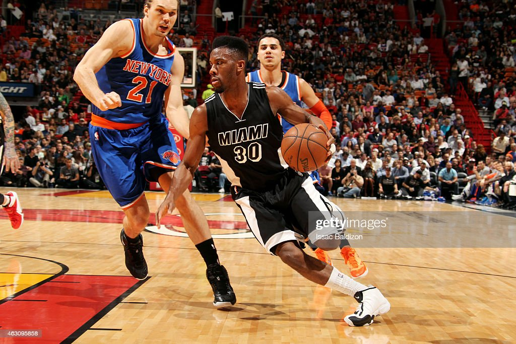 Norris Cole of the Miami Heat drives against the New York Knicks on February 9 2015 at American Airlines Arena in Miami Florida NOTE TO USER User...