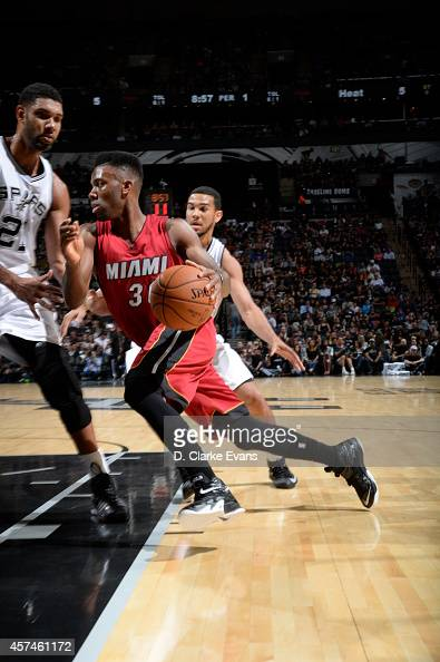 Norris Cole of the Miami Heat drives against the San Antonio Spurs at the ATT Center on October 18 2014 in San Antonio Texas NOTE TO USER User...