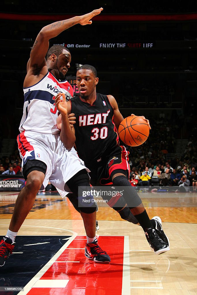 <a gi-track='captionPersonalityLinkClicked' href=/galleries/search?phrase=Norris+Cole&family=editorial&specificpeople=5770147 ng-click='$event.stopPropagation()'>Norris Cole</a> #30 of the Miami Heat drives against Trevor Booker #35 of the Washington Wizards during the game at the Verizon Center on February 10, 2012 in Washington, DC.