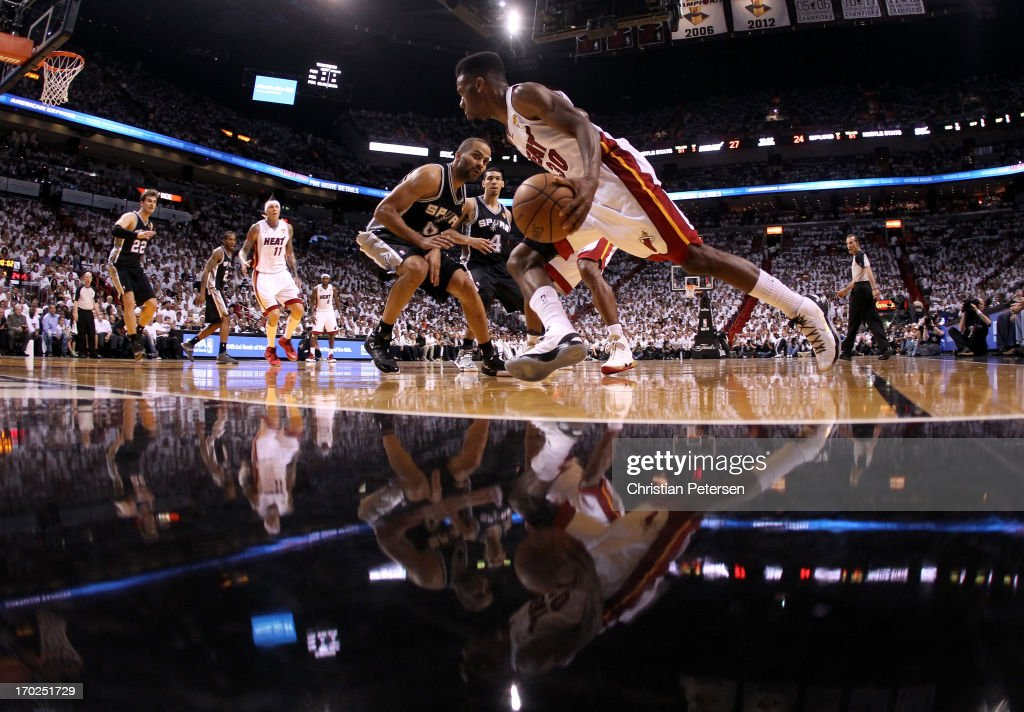 Norris Cole of the Miami Heat drives on Tony Parker of the San Antonio Spurs in the first half during Game Two of the 2013 NBA Finals at...