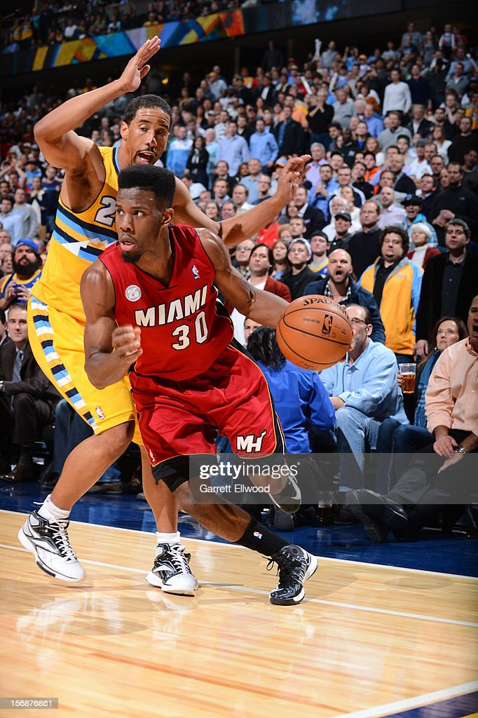 <a gi-track='captionPersonalityLinkClicked' href=/galleries/search?phrase=Norris+Cole&family=editorial&specificpeople=5770147 ng-click='$event.stopPropagation()'>Norris Cole</a> #30 of the Miami Heat drives to the basket against <a gi-track='captionPersonalityLinkClicked' href=/galleries/search?phrase=Andre+Miller&family=editorial&specificpeople=201678 ng-click='$event.stopPropagation()'>Andre Miller</a> #24 of the Denver Nuggets on November 15, 2012 at the Pepsi Center in Denver, Colorado.