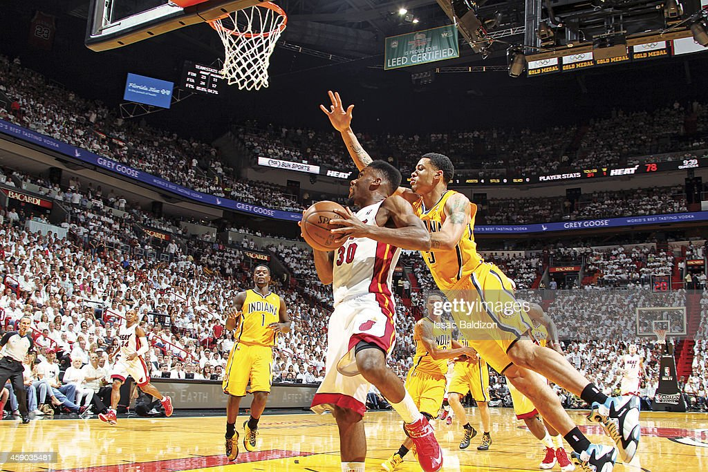 <a gi-track='captionPersonalityLinkClicked' href=/galleries/search?phrase=Norris+Cole&family=editorial&specificpeople=5770147 ng-click='$event.stopPropagation()'>Norris Cole</a> #30 of the Miami Heat drives to the basket against <a gi-track='captionPersonalityLinkClicked' href=/galleries/search?phrase=Dominic+McGuire&family=editorial&specificpeople=2537986 ng-click='$event.stopPropagation()'>Dominic McGuire</a> #5 of the Indiana Pacers in Game Seven of the Eastern Conference Finals during the 2013 NBA Playoffs on June 3, 2013 at American Airlines Arena in Miami, Florida.