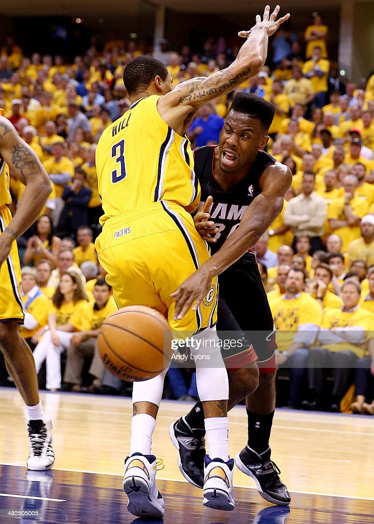 Norris Cole of the Miami Heat drives to the basket against George Hill of the Indiana Pacers during Game Two of the Eastern Conference Finals of the...