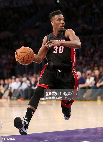Norris Cole of the Miami Heat drives with the ball against the Los Angeles Lakers at Staples Center on January 13 2015 in Los Angeles California The...
