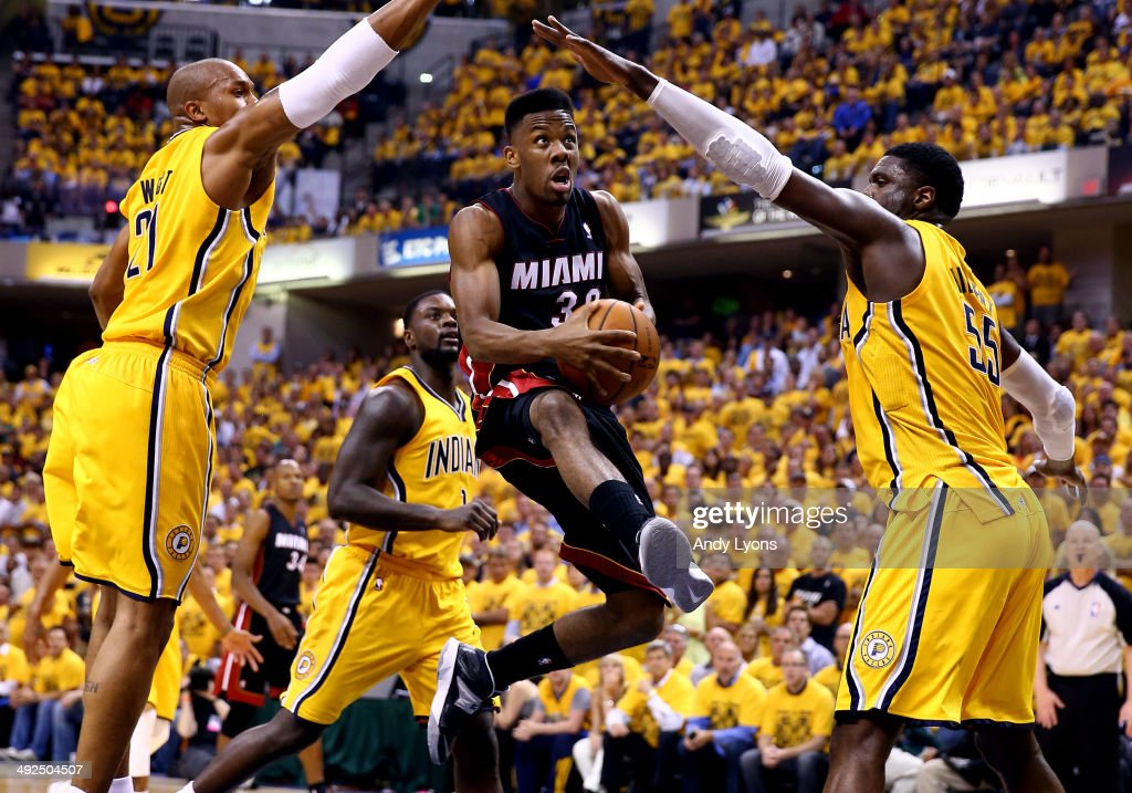Norris Cole of the Miami Heat goes to the basket as David West and Roy Hibbert of the Indiana Pacers defend during Game Two of the Eastern Conference...
