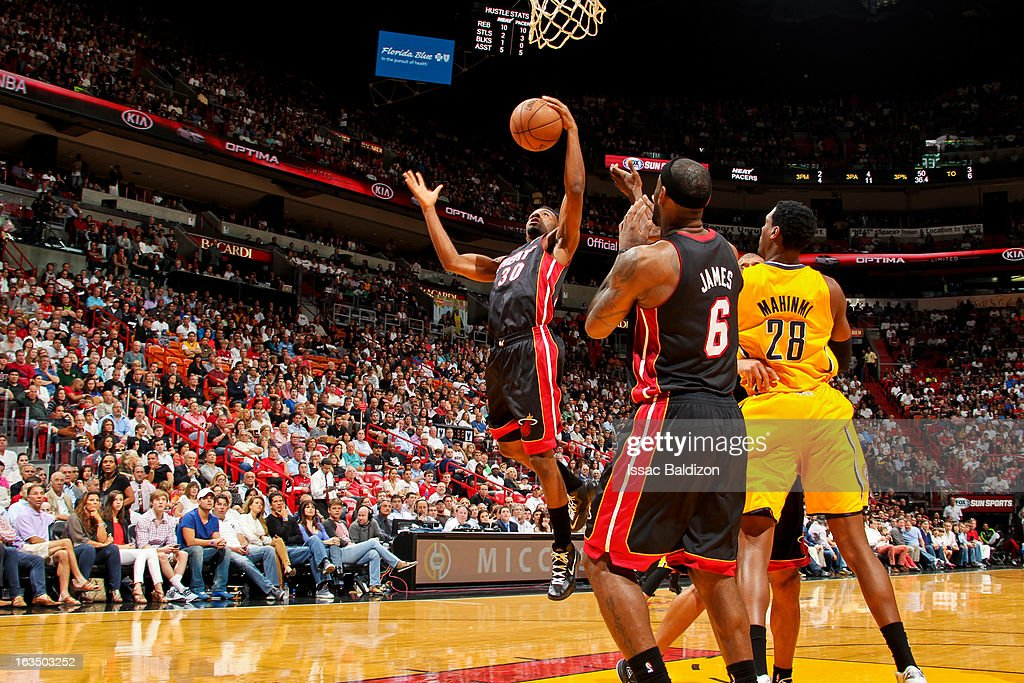 Norris Cole #30 of the Miami Heat grabs a rebound against the Indiana Pacers on March 10, 2013 at American Airlines Arena in Miami, Florida.
