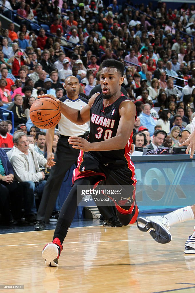 Norris Cole #30 of the Miami Heat handles the ball against the New Orleans Pelicans on March 22, 2014 at the Smoothie King Center in New Orleans, Louisiana.