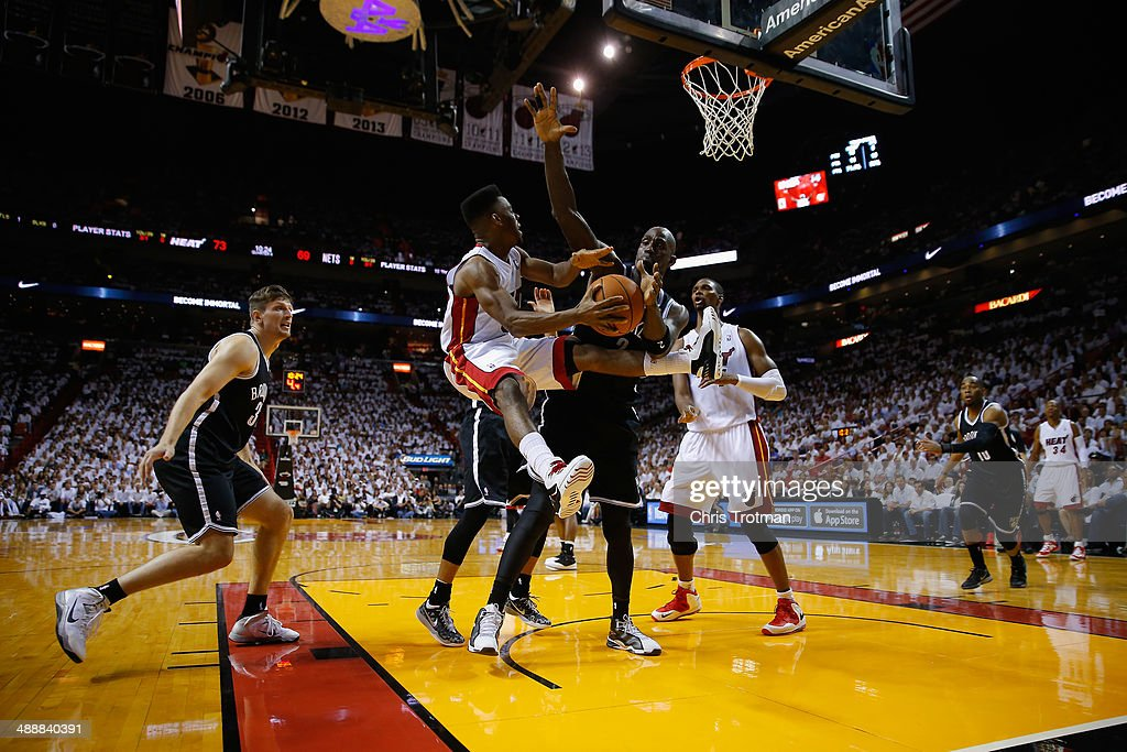 <a gi-track='captionPersonalityLinkClicked' href=/galleries/search?phrase=Norris+Cole&family=editorial&specificpeople=5770147 ng-click='$event.stopPropagation()'>Norris Cole</a> #30 of the Miami Heat is guarded by <a gi-track='captionPersonalityLinkClicked' href=/galleries/search?phrase=Kevin+Garnett&family=editorial&specificpeople=201473 ng-click='$event.stopPropagation()'>Kevin Garnett</a> #2 of the Brooklyn Nets during Game Two of the Eastern Conference Semifinals of the 2014 NBA Playoffs at American Airlines Arena on May 8, 2014 in Miami, Florida.