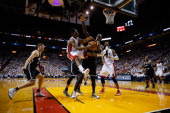 Norris Cole of the Miami Heat is guarded by Kevin Garnett of the Brooklyn Nets during Game Two of the Eastern Conference Semifinals of the 2014 NBA...