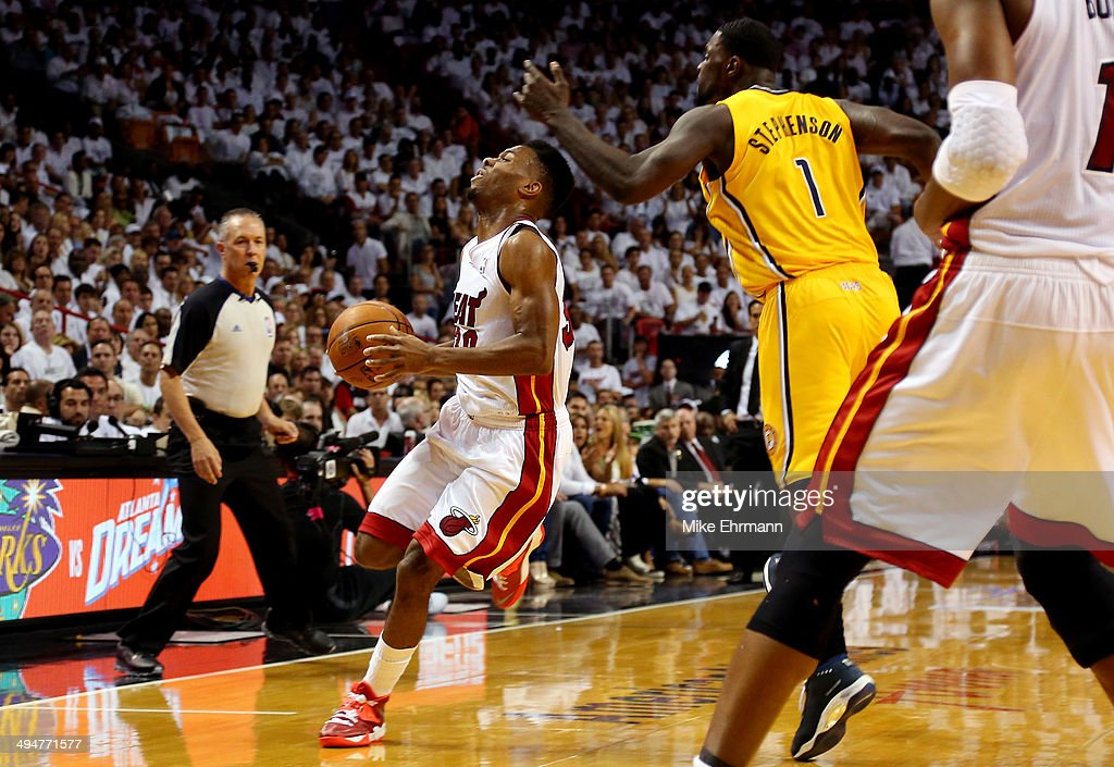 <a gi-track='captionPersonalityLinkClicked' href=/galleries/search?phrase=Norris+Cole&family=editorial&specificpeople=5770147 ng-click='$event.stopPropagation()'>Norris Cole</a> #30 of the Miami Heat is hit in the face by <a gi-track='captionPersonalityLinkClicked' href=/galleries/search?phrase=Lance+Stephenson&family=editorial&specificpeople=5298304 ng-click='$event.stopPropagation()'>Lance Stephenson</a> #1 of the Indiana Pacers during Game Six of the Eastern Conference Finals of the 2014 NBA Playoffs at American Airlines Arena on May 30, 2014 in Miami, Florida.