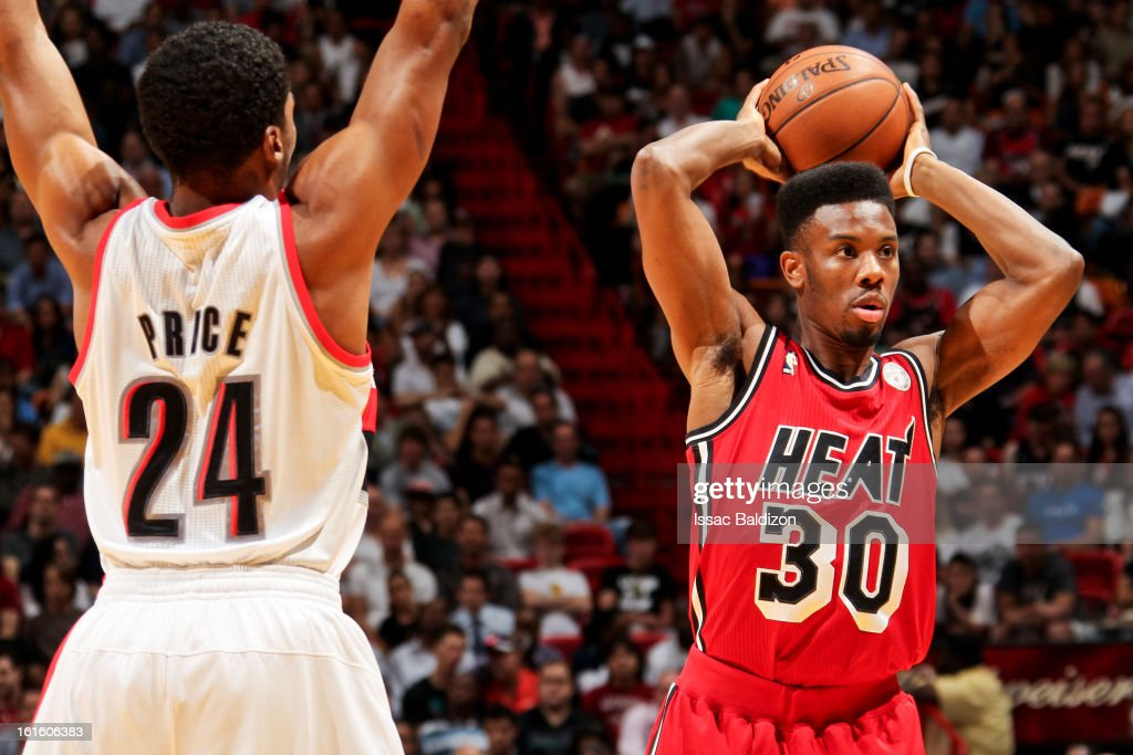 Norris Cole #30 of the Miami Heat looks to pass the ball against Ronnie Price #24 of the Portland Trail Blazers on February 12, 2013 at American Airlines Arena in Miami, Florida.