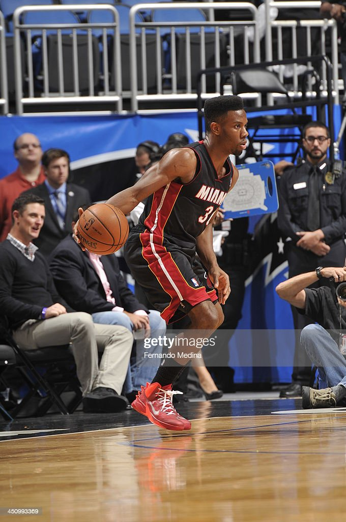 Norris Cole #30 of the Miami Heat looks to pass the ball against the Orlando Magic during the game on November 20, 2013 at Amway Center in Orlando, Florida.