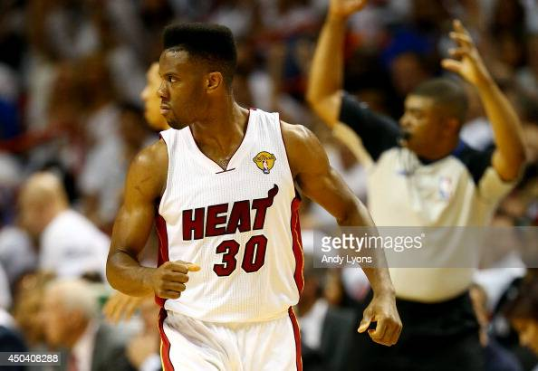 Norris Cole of the Miami Heat reacts after hitting a shot against the San Antonio Spurs during Game Three of the 2014 NBA Finals at American Airlines...