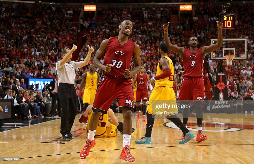 Norris Cole of the Miami Heat reacts to a play during a game against the Cleveland Cavaliers at American Airlines Arena on December 25 2014 in Miami...