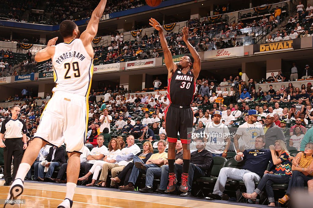 <a gi-track='captionPersonalityLinkClicked' href=/galleries/search?phrase=Norris+Cole&family=editorial&specificpeople=5770147 ng-click='$event.stopPropagation()'>Norris Cole</a> #30 of the Miami Heat shoots a three against Jeff Pendergraph #29 of the Indiana Pacers in Game Three of the Eastern Conference Finals during the 2013 NBA Playoffs on May 26, 2013 at Bankers Life Fieldhouse in Indianapolis, Indiana.