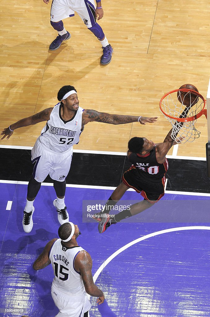 <a gi-track='captionPersonalityLinkClicked' href=/galleries/search?phrase=Norris+Cole&family=editorial&specificpeople=5770147 ng-click='$event.stopPropagation()'>Norris Cole</a> #30 of the Miami Heat shoots against James Johnson #52 of the Sacramento Kings on January 12, 2013 at Sleep Train Arena in Sacramento, California.