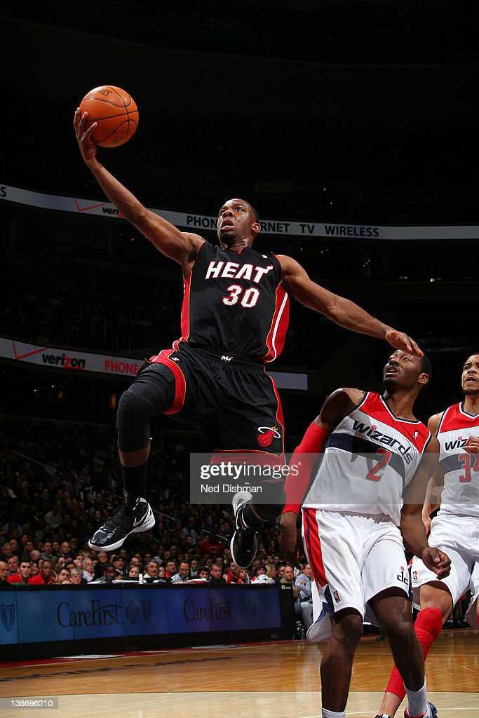 <a gi-track='captionPersonalityLinkClicked' href=/galleries/search?phrase=Norris+Cole&family=editorial&specificpeople=5770147 ng-click='$event.stopPropagation()'>Norris Cole</a> #30 of the Miami Heat shoots against <a gi-track='captionPersonalityLinkClicked' href=/galleries/search?phrase=John+Wall&family=editorial&specificpeople=2265812 ng-click='$event.stopPropagation()'>John Wall</a> #2 of the Washington Wizards during the game at the Verizon Center on February 10, 2012 in Washington, DC.