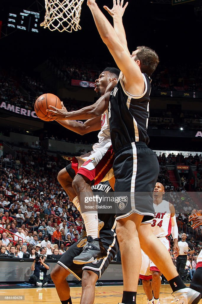Norris Cole #30 of the Miami Heat shoots against the Brooklyn Nets at the American Airlines Arena in Miami, Florida on April, 8 2014.
